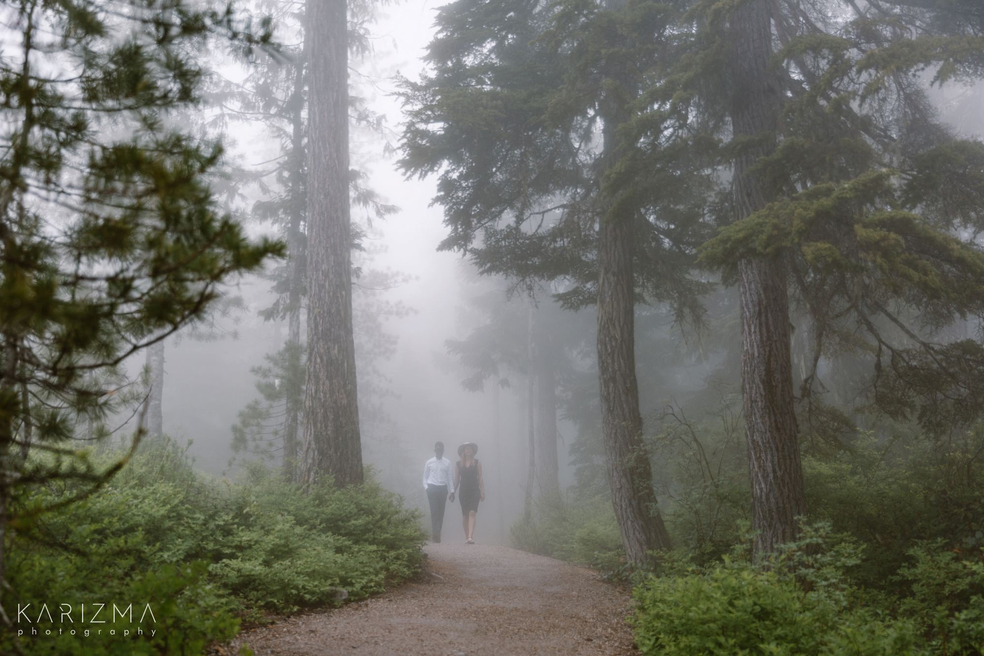 Squamish Engagement Session couplke walking hand in hand in the fog