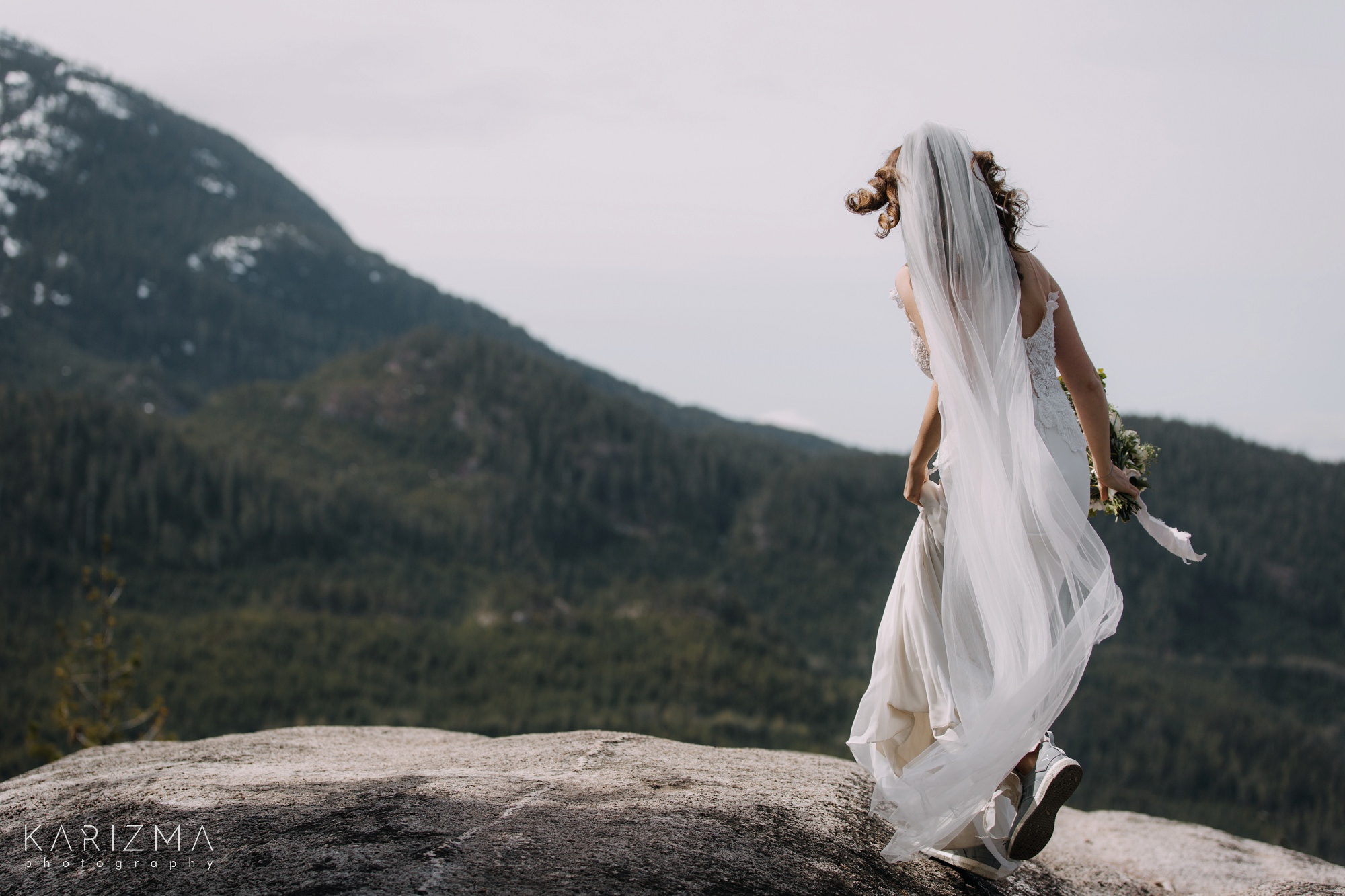 Squamish Wedding Photography bride walking on the cliffs