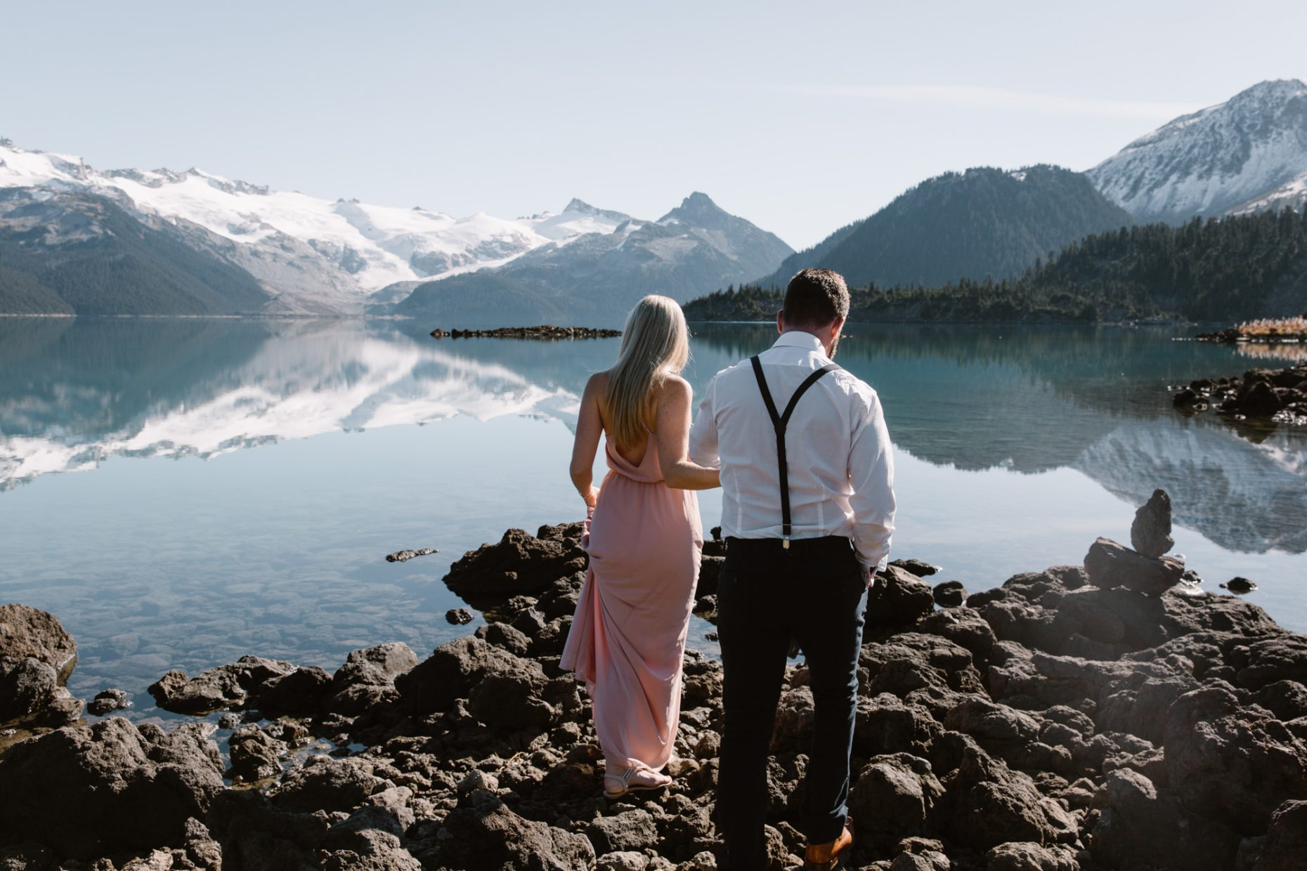 engagement photo on Garibaldi lake, couple walking towards the mountains