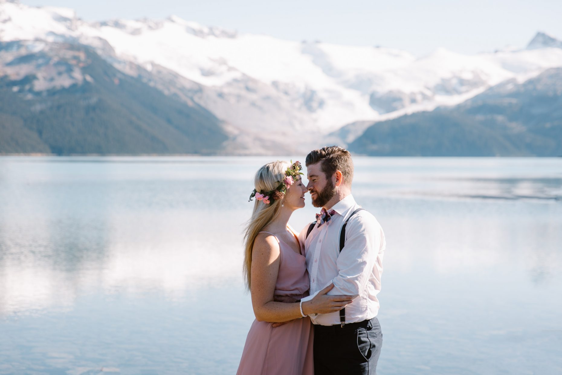 kissing couple with mountain backdrop