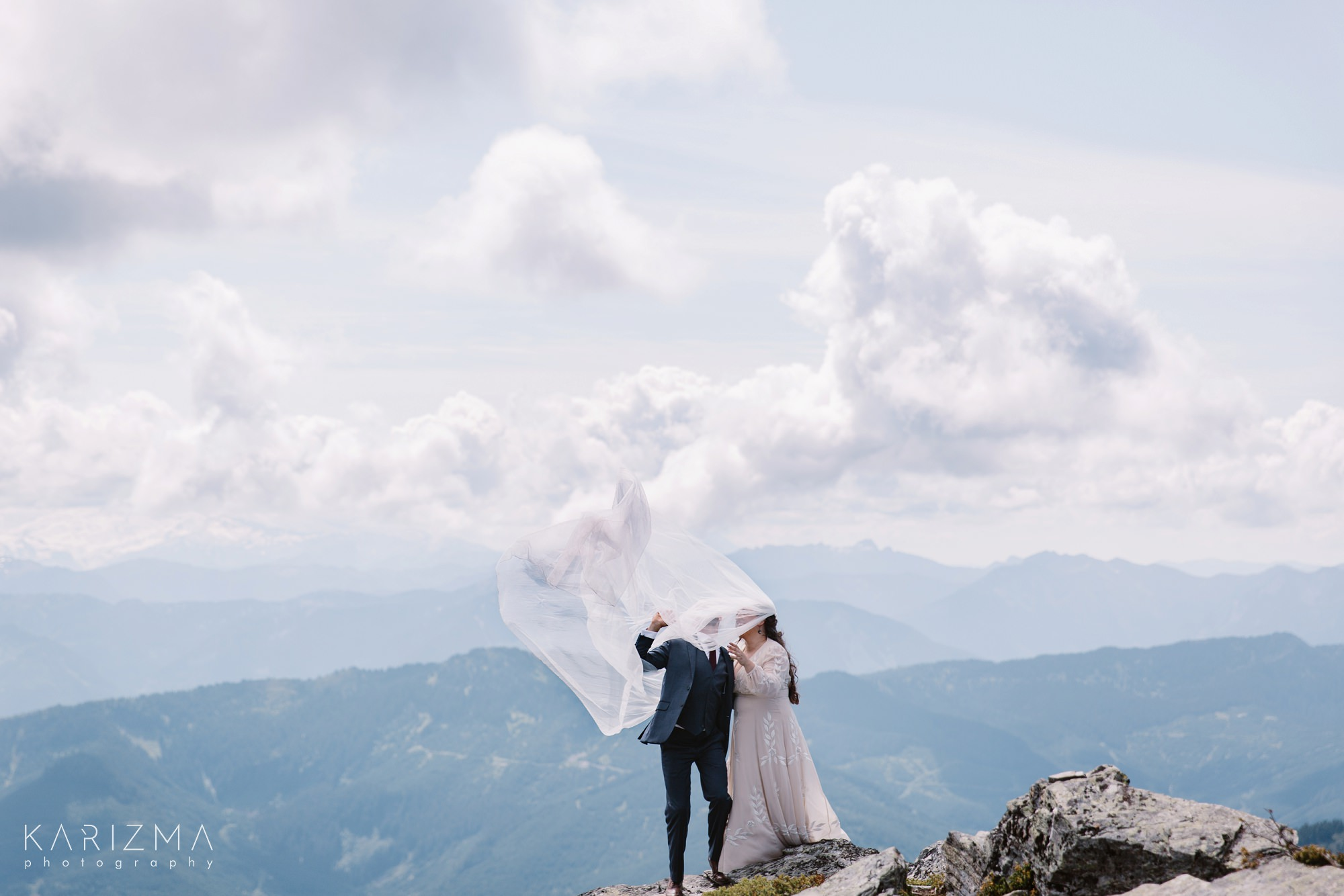 Bride and groom at the top of the mountain