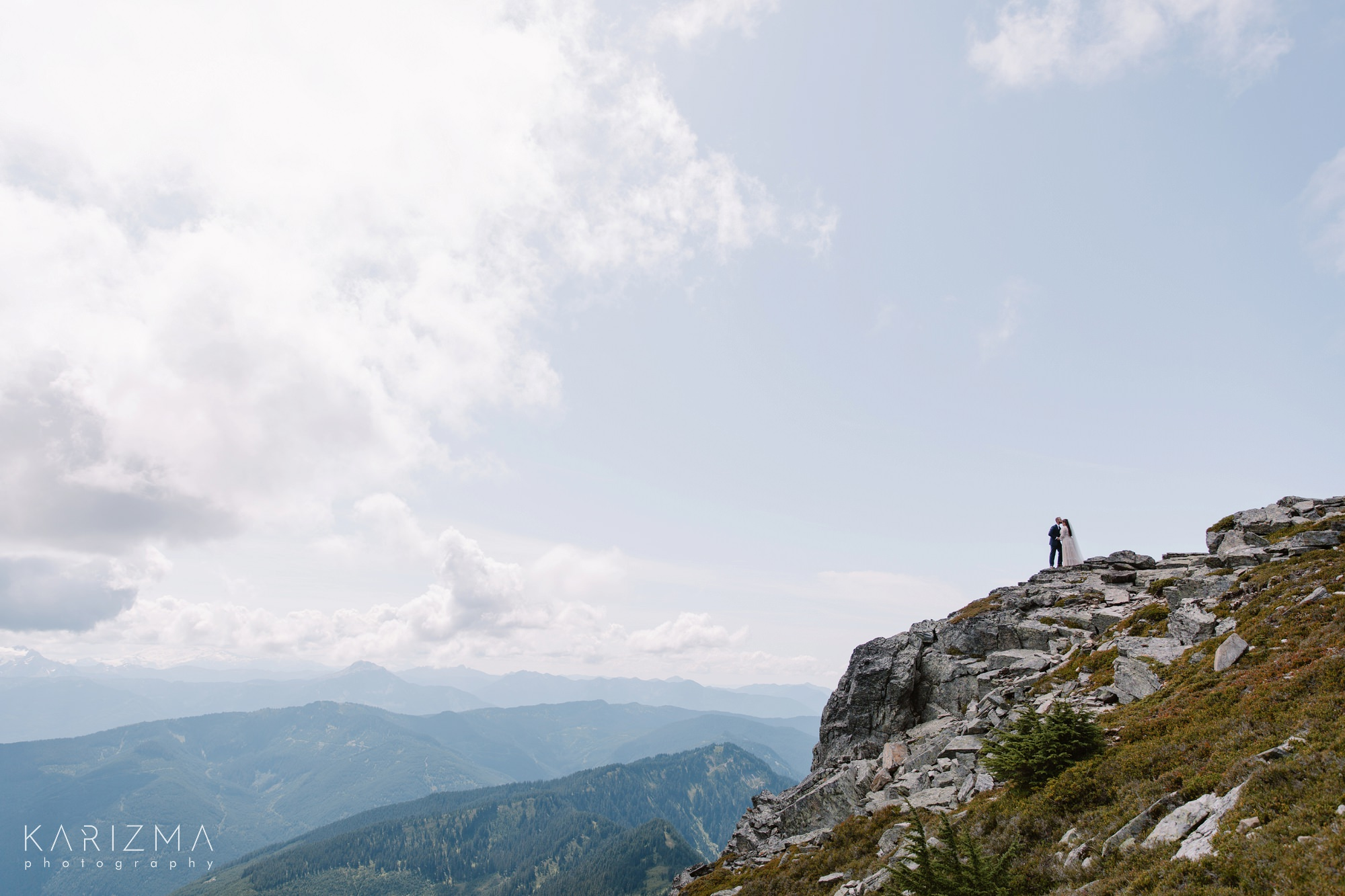 Bride and groom are kissing in the mountains