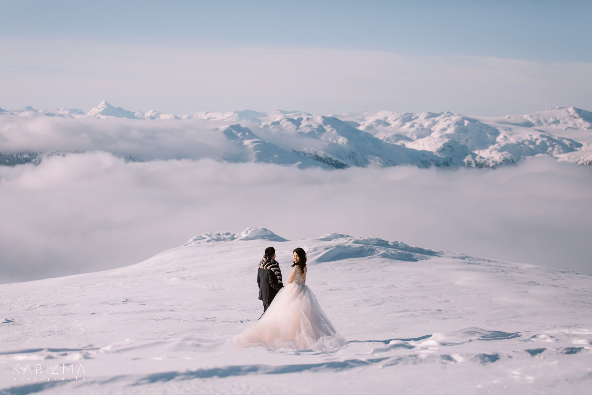 Bride and groom posing for their whistler pre-wedding photos in the mountains