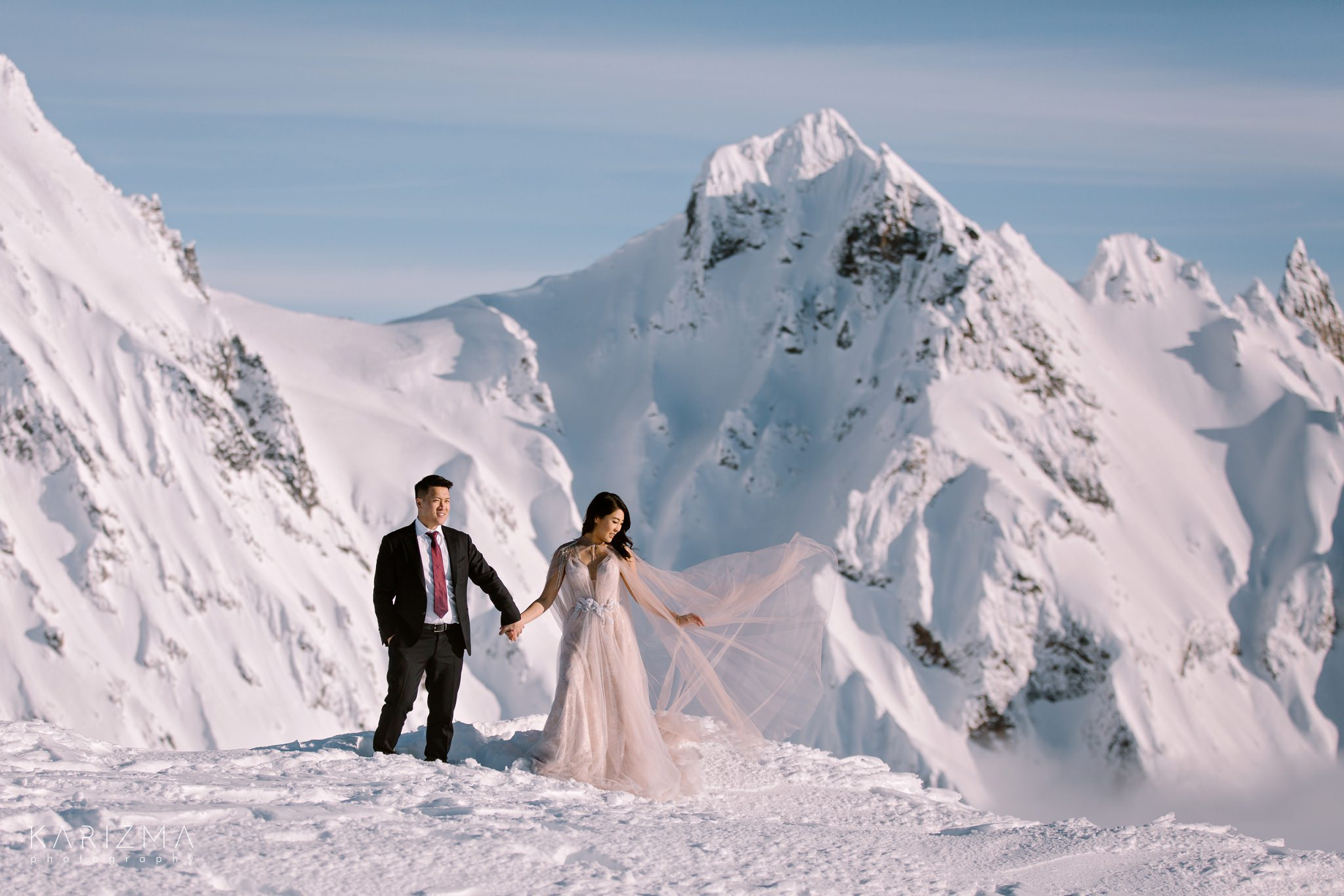 Bride is playing with her wedding dress Afina by Ange Etoiles in the mountains