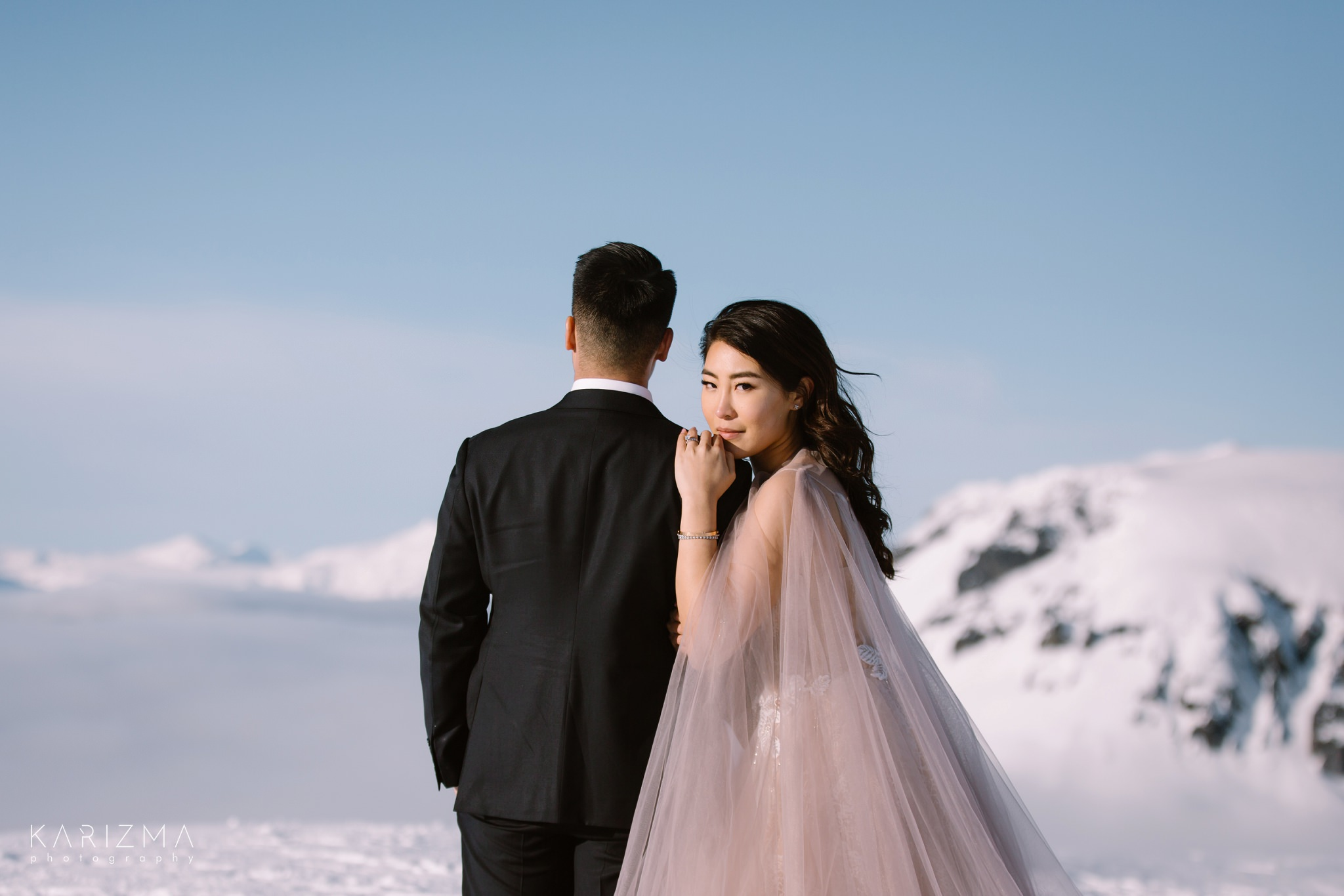 Winter close-up portrait of the bride and groom in the snowy mountains of British Columbia