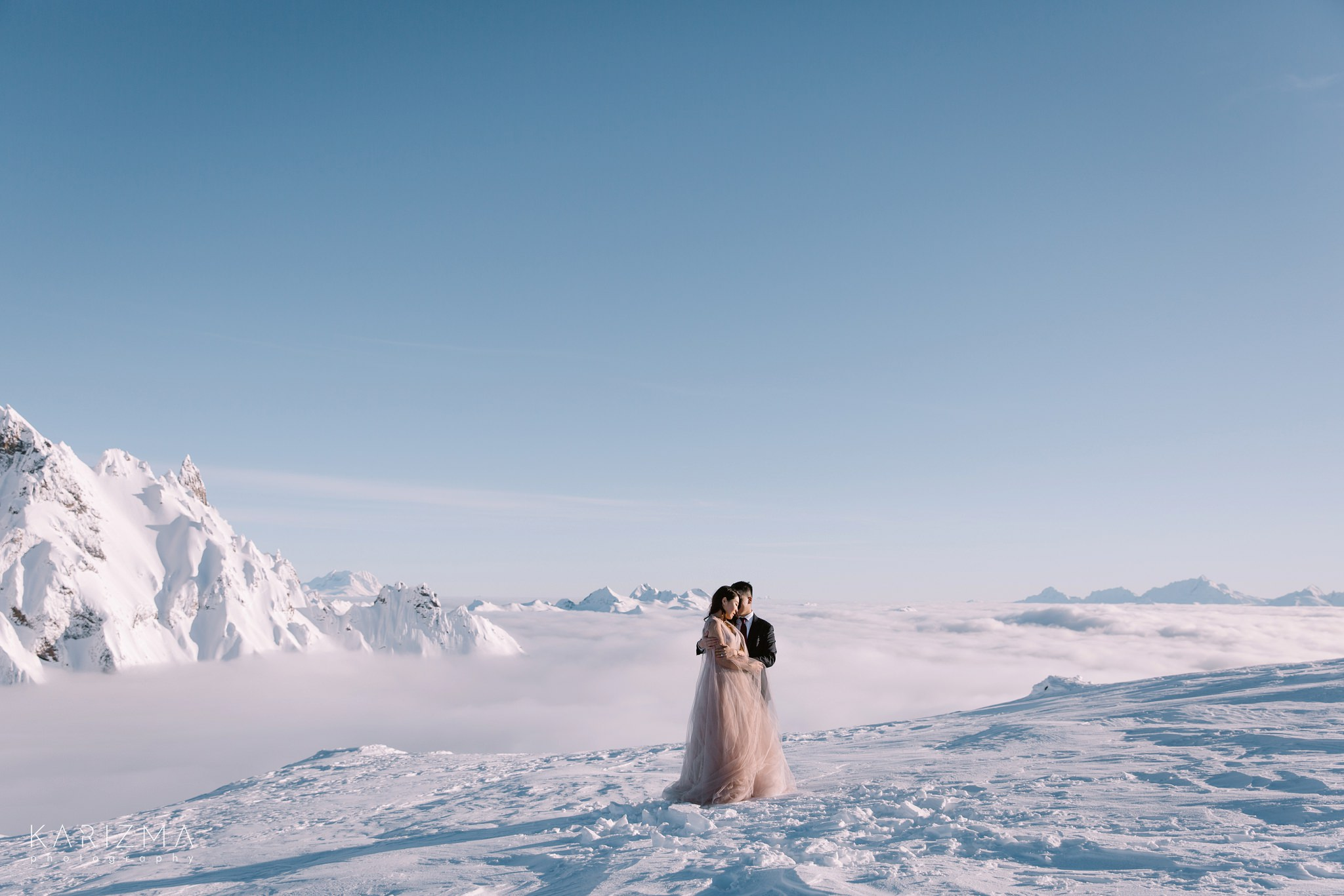 Bride in her blush wedding dress Afina by Rara Avis posing for her pre-wedding photos in the mountains of British Columbia