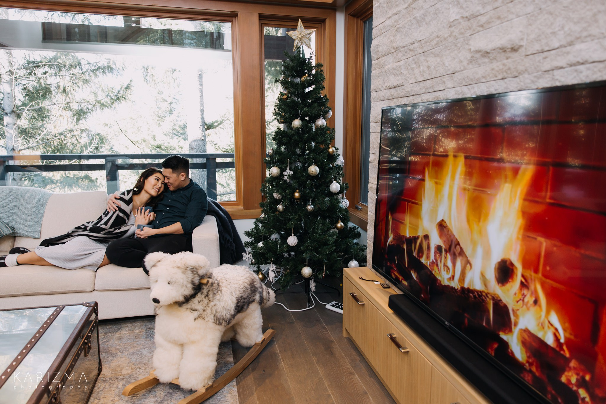 Sweet couple is cuddling on the couch during their Whistler engagement session