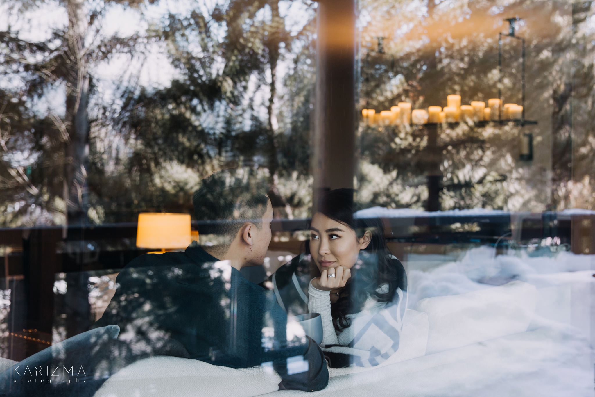 Portrait of a bride and groom taken through the window with beautiful reflection