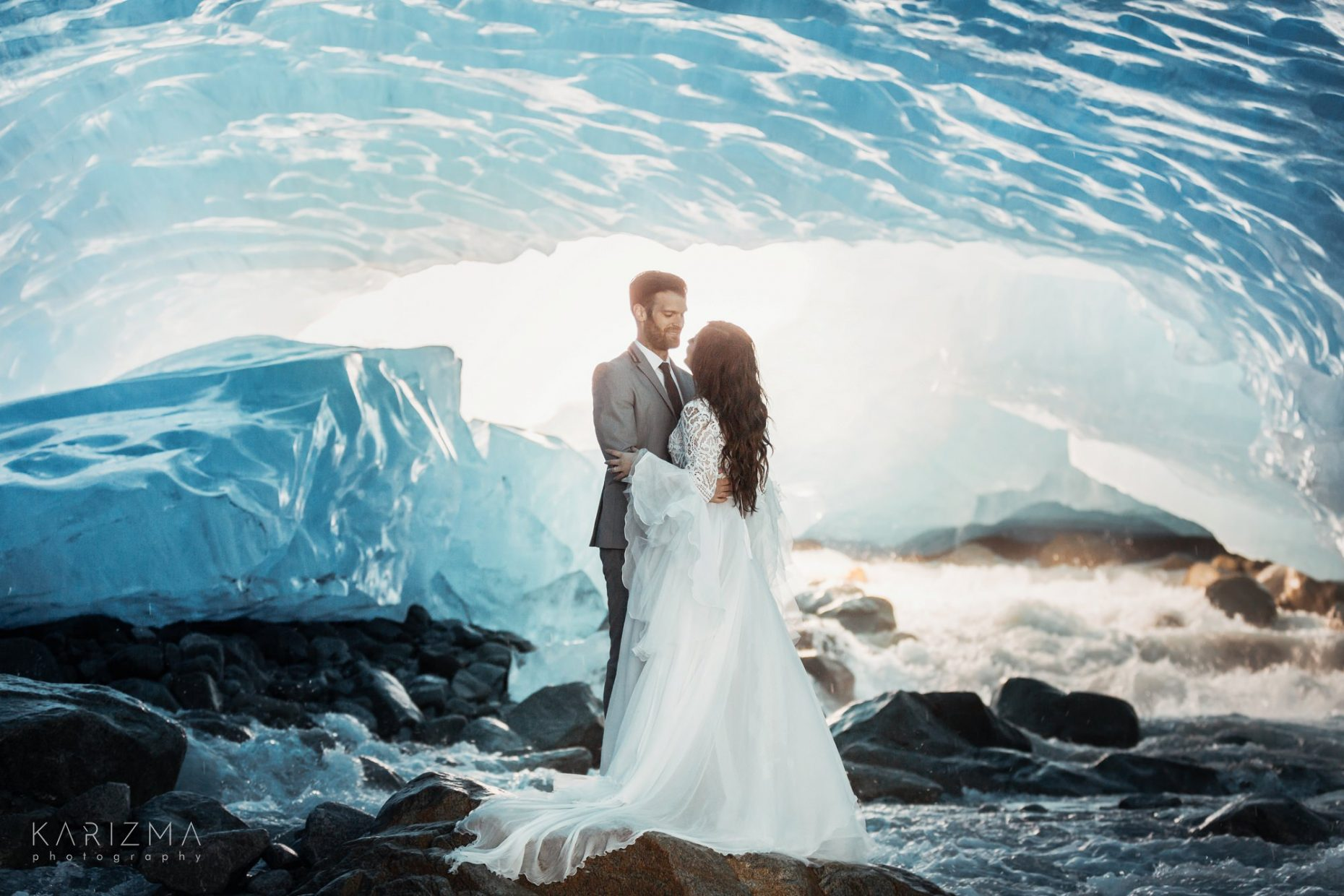 ice cave wedding, couple posing on the rocks
