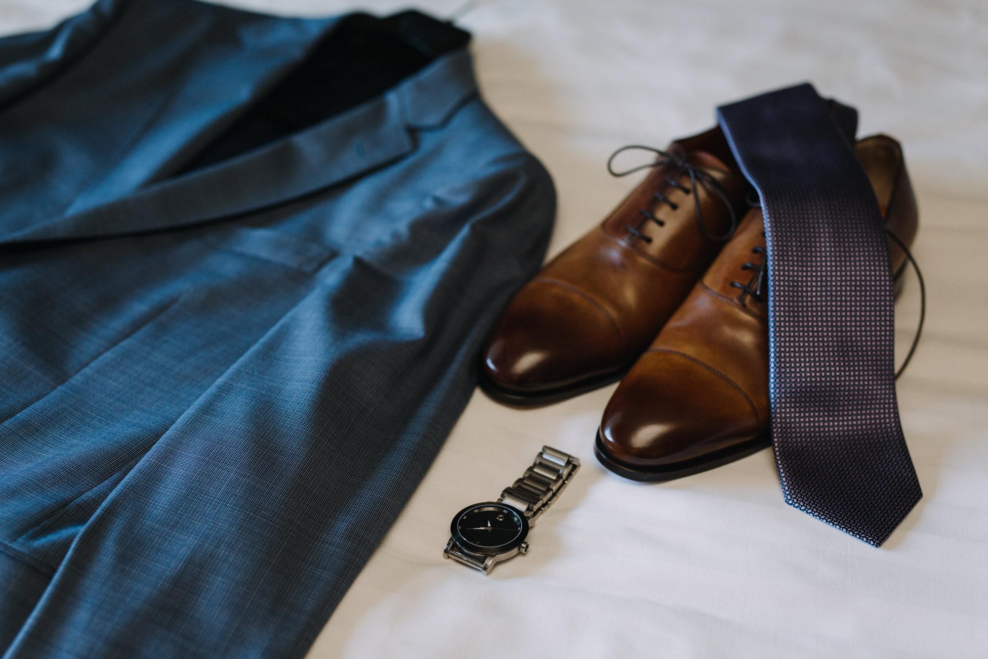 Groom's wedding accessories - jacket, shoes, watch, tie