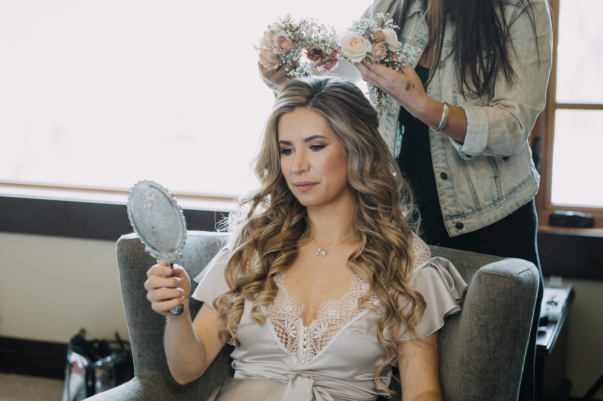 Bride trying on her floral while getting ready for her big day