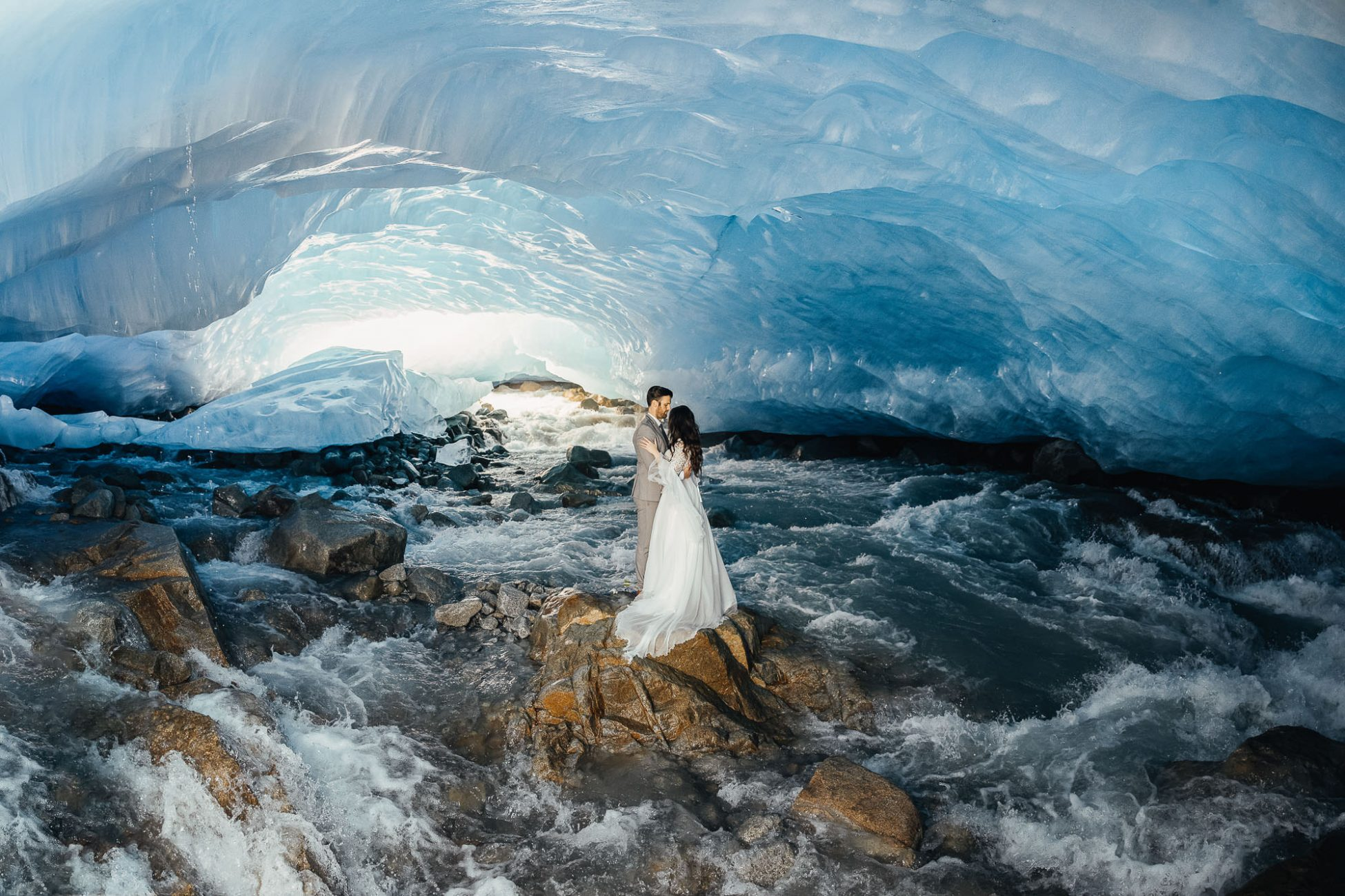 Bride and groom are standing in the Whistler Ice Cave posing for wedding photos