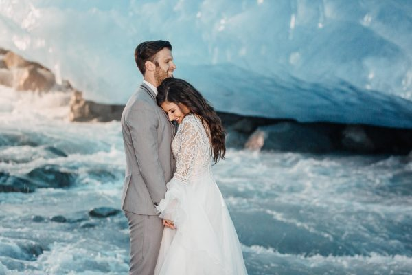 Bride and groom cuddling up in the ice cave