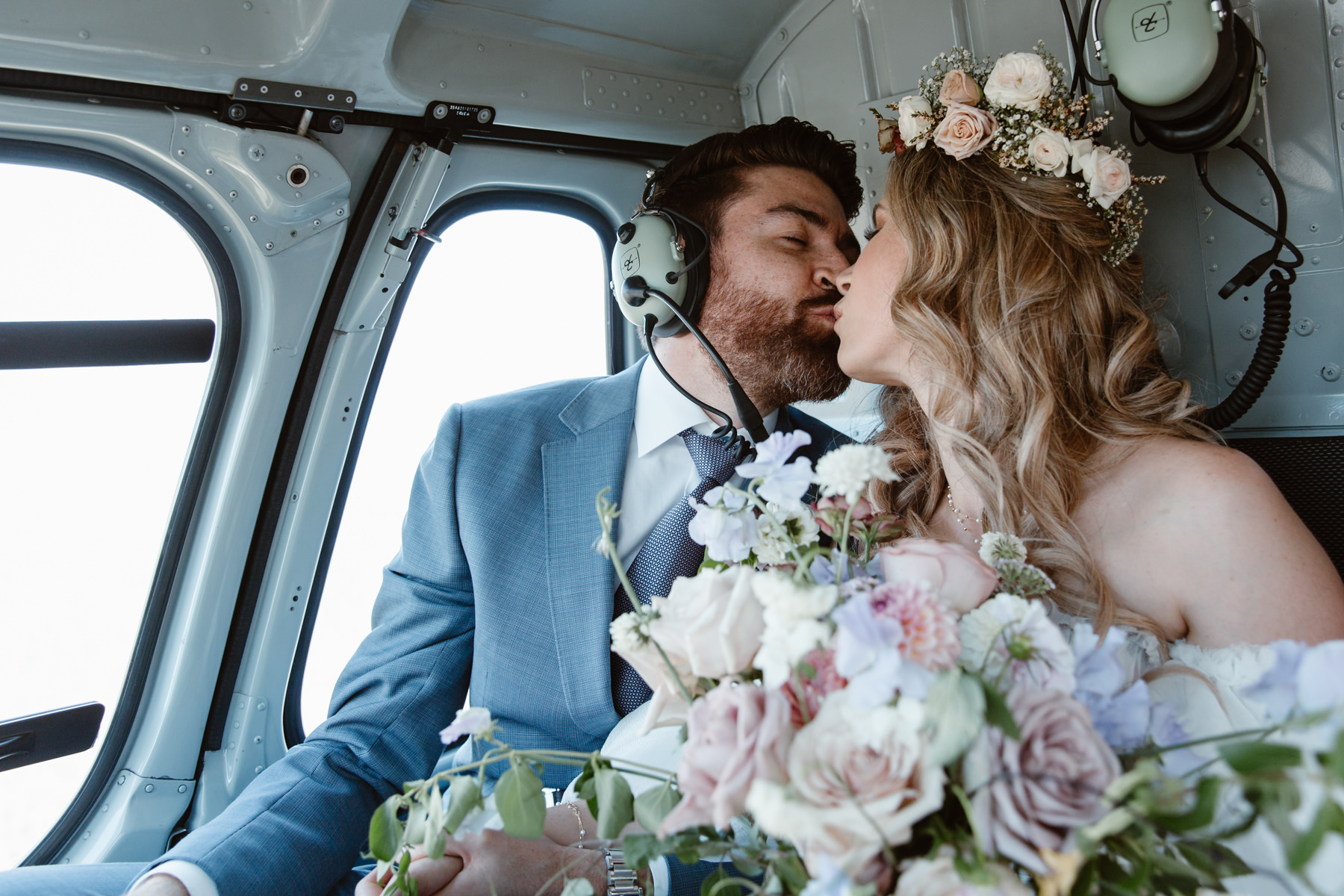 Helicopter elopement packages BC - couple kissing in a helicopter