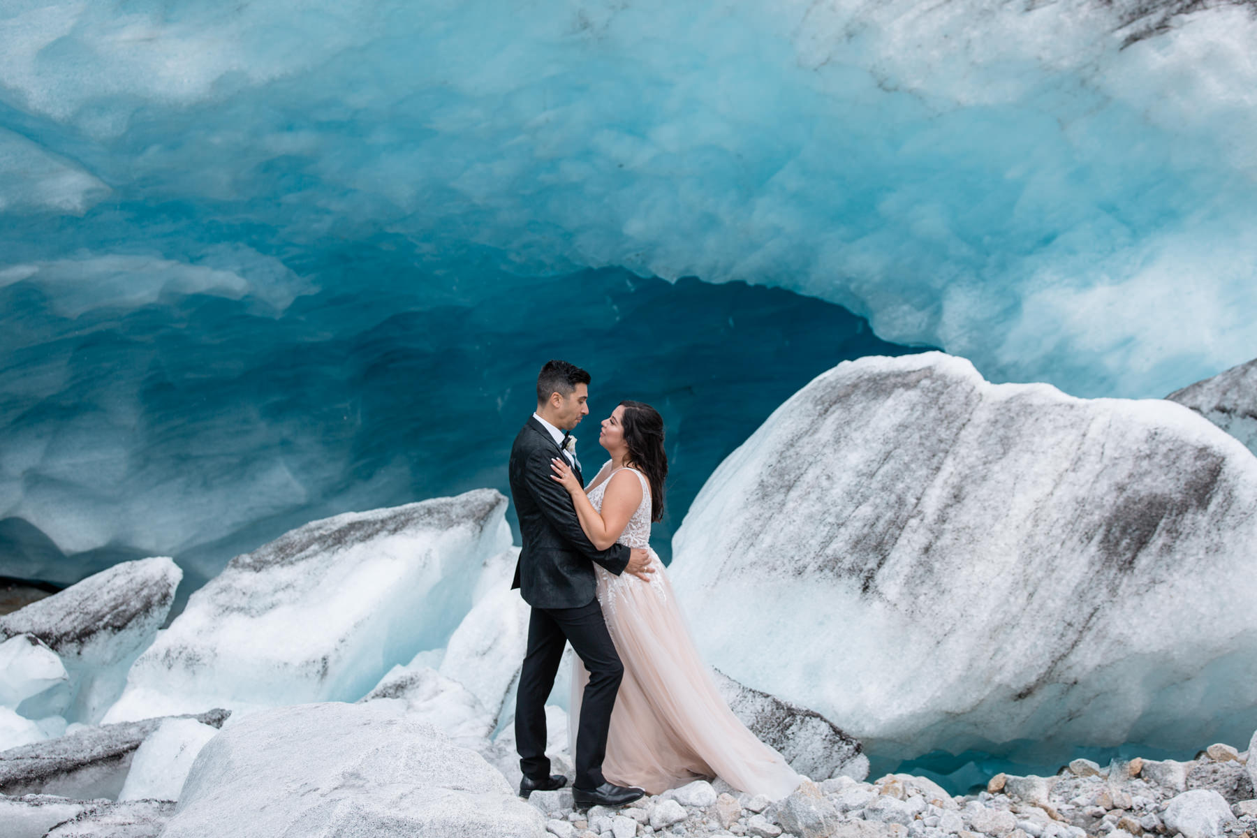 Helicopter elopement packages BC - ice cave wedding